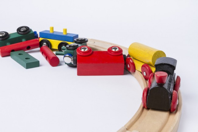 Child's wooden train depicting a train crash